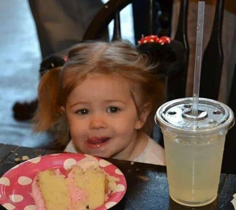 Little Girl with Cake and Drink